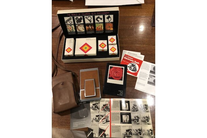 1970'S POLAROID SX-70 LAND CAMERA W/Case & STRAP + NOS ACCESSORY KIT (5 PIECE)